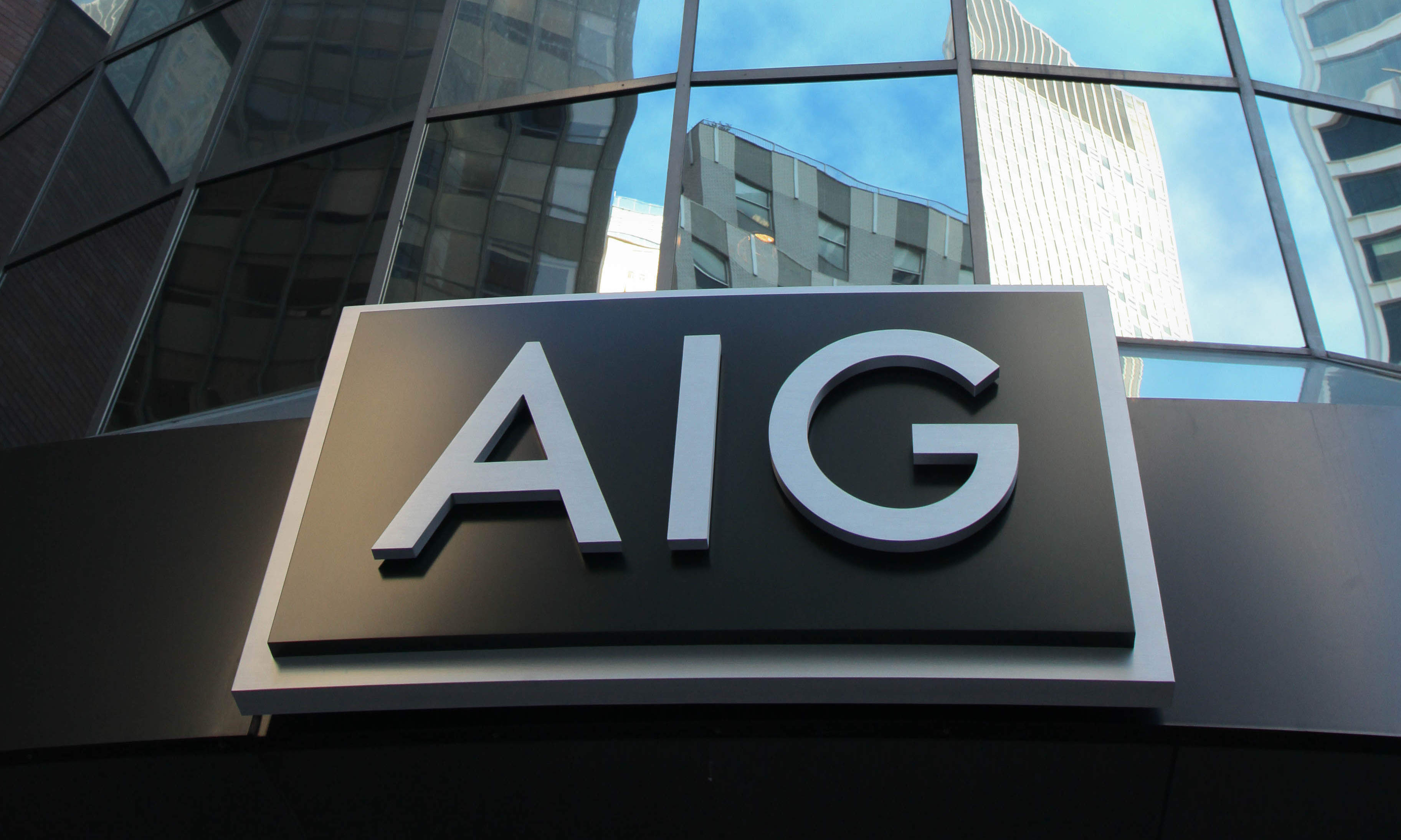 AIG resolves tax shelter lawsuit by agreeing to give up over $400m in tax credits